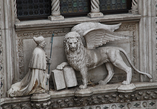 Andrea Gritti kneeling in front of the lion of St. Mark. Venice, central balcony of the The Doge's Palace